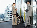 Office workers waiting for lift Stock Photo - Premium Royalty-Free, Artist: Andrew Kolb, Code: 6114-06602652