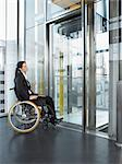 Woman waiting for lift Stock Photo - Premium Royalty-Free, Artist: Blend Images, Code: 6114-06602659