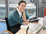 Woman sat at desk Stock Photo - Premium Royalty-Free, Artist: CulturaRM, Code: 6114-06602664