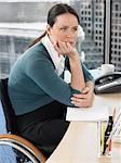 Woman sat at desk Stock Photo - Premium Royalty-Free, Artist: CulturaRM, Code: 6114-06602686