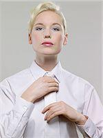 Woman wearing white shirt and tie Stock Photo - Premium Royalty-Freenull, Code: 6114-06602716