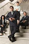 Businesspeople on stairs Stock Photo - Premium Royalty-Free, Artist: Blend Images, Code: 6114-06602729