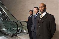 Businessmen by escalators Stock Photo - Premium Royalty-Freenull, Code: 6114-06602738