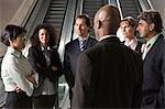 Businesspeople by escalators Stock Photo - Premium Royalty-Free, Artist: Blend Images, Code: 6114-06602741