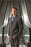 Businessman by escalator Stock Photo - Premium Royalty-Free, Artist: Blend Images, Code: 6114-06602756