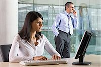 secretary desk - Executive using cell phone Stock Photo - Premium Royalty-Freenull, Code: 6114-06602783