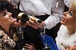 Waiter pouring two women champagne Stock Photo - Premium Royalty-Free, Artist: Blend Images, Code: 6114-06602880
