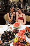 Two women wearing underwear enjoying a banquet Stock Photo - Premium Royalty-Free, Artist: Cultura RM, Code: 6114-06602890