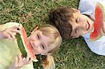 Kids eating watermelon Stock Photo - Premium Royalty-Free, Artist: CulturaRM, Code: 6114-06602912