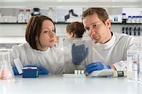 Two scientists looking at DNA Stock Photo - Premium Royalty-Freenull, Code: 6114-06603087