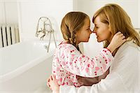 Girl and daughter rubbing noses Stock Photo - Premium Royalty-Freenull, Code: 6114-06603162