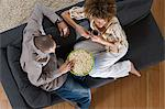 Couple sitting on sofa Stock Photo - Premium Royalty-Freenull, Code: 6114-06603233