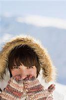 Woman wearing mittens Stock Photo - Premium Royalty-Freenull, Code: 6114-06603318