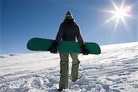 Female snowboarder Stock Photo - Premium Royalty-Freenull, Code: 6114-06603338