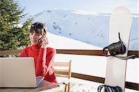 Snowboarder using laptop Stock Photo - Premium Royalty-Freenull, Code: 6114-06603342