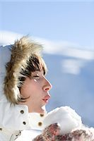 Woman holding snowball Stock Photo - Premium Royalty-Freenull, Code: 6114-06603383