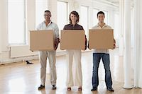 entry field - Colleagues carrying cardboard boxes Stock Photo - Premium Royalty-Freenull, Code: 6114-06603431