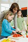 Family preparing food Stock Photo - Premium Royalty-Free, Artist: Photocuisine, Code: 6114-06603606