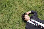 Businessman lying on grass Stock Photo - Premium Royalty-Free, Artist: Robert Harding Images, Code: 6114-06603616