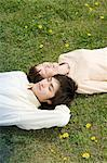 Couple lying on the grass Stock Photo - Premium Royalty-Free, Artist: Robert Harding Images, Code: 6114-06603621