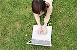 Woman lying on grass using laptop computer Stock Photo - Premium Royalty-Free, Artist: Robert Harding Images, Code: 6114-06603656
