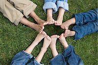 Kids with feet in a circle Stock Photo - Premium Royalty-Freenull, Code: 6114-06603830
