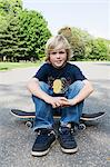 Skateboarder boy Stock Photo - Premium Royalty-Free, Artist: Blend Images, Code: 6114-06603831