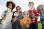 Kids with lollipops Stock Photo - Premium Royalty-Free, Artist: Jodi Pudge, Code: 6114-06603834