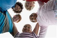 five - Friends in a huddle Stock Photo - Premium Royalty-Freenull, Code: 6114-06603854