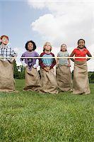 finish line - Kids near finish line in sack race Stock Photo - Premium Royalty-Freenull, Code: 6114-06603856