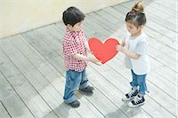 Children holding a heart shape Stock Photo - Premium Royalty-Freenull, Code: 6114-06603886