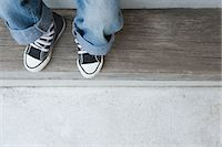 A child wearing jeans and trainers Stock Photo - Premium Royalty-Freenull, Code: 6114-06603909