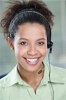 Smiling female telephonist Stock Photo - Premium Royalty-Freenull, Code: 6114-06603959