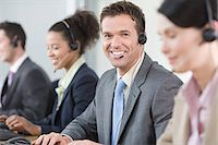 switchboard operator - Row of smiling telephonists Stock Photo - Premium Royalty-Freenull, Code: 6114-06603966