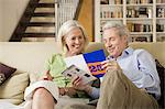 Senior couple looking at a brochure Stock Photo - Premium Royalty-Free, Artist: AWL Images, Code: 6114-06603992