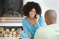 person on phone with credit card - Woman shopping over the telephone Stock Photo - Premium Royalty-Freenull, Code: 6114-06604001
