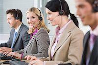 Smiling female telephonist Stock Photo - Premium Royalty-Freenull, Code: 6114-06604014