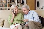 Senior couple looking at a brochure Stock Photo - Premium Royalty-Freenull, Code: 6114-06604027