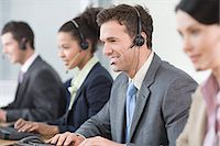 switchboard operator - Smiling telephonists Stock Photo - Premium Royalty-Freenull, Code: 6114-06604030