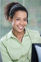 switchboard operator - Smiling female telephonist Stock Photo - Premium Royalty-Freenull, Code: 6114-06604042