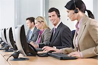 switchboard operator - Row of telephonists Stock Photo - Premium Royalty-Freenull, Code: 6114-06604045