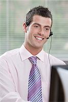 switchboard operator - Smiling male telephonist Stock Photo - Premium Royalty-Freenull, Code: 6114-06604048