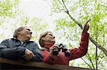 Mature couple with binoculars Stock Photo - Premium Royalty-Free, Artist: Cultura RM, Code: 6114-06604056