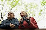 Mature couple with binoculars Stock Photo - Premium Royalty-Free, Artist: CulturaRM, Code: 6114-06604070