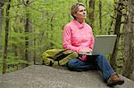 Mature woman using a laptop computer in forest Stock Photo - Premium Royalty-Free, Artist: Cultura RM, Code: 6114-06604087