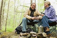 Mature couple camping in forest Stock Photo - Premium Royalty-Freenull, Code: 6114-06604091