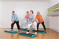 fitness older women gym - Mature adults doing step aerobics Stock Photo - Premium Royalty-Freenull, Code: 6114-06604403
