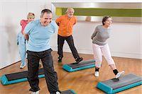 fitness older women gym - Mature adults doing step aerobics Stock Photo - Premium Royalty-Freenull, Code: 6114-06604417