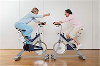 fitness older women gym - Women on exercise bikes Stock Photo - Premium Royalty-Freenull, Code: 6114-06604425