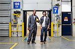 Two male factory workers Stock Photo - Premium Royalty-Free, Artist: Blend Images, Code: 6114-06604486